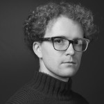 Black and white headshot of ethnographic photographer Amadeusz Kazubowski-Houston.