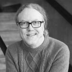 Black and white headshot of co-editor, acting coach, Shawn Kazubowski-Houston.